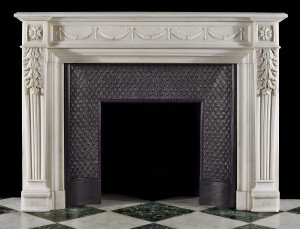 This Carrara marble fireplace mantel has been carved from solid white Carrara marble for custom built high end residences in New York.