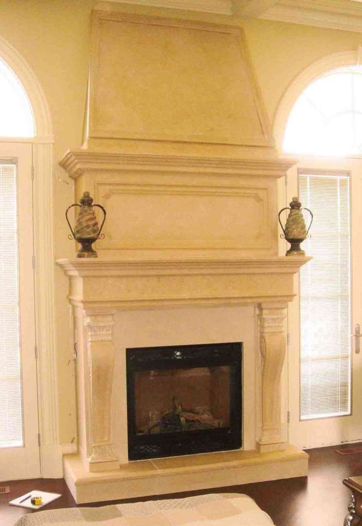 Two story limestone living room fireplace mantel is incredible in a home. This will enhance and accentuate the look and beauty of your custom built home.